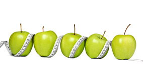 Fresh green apples with measuring tape Royalty Free Stock Image