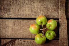 Fresh green apples on an old box. Healthy organic food. Top view,  Flat lay. with free text space Stock Image