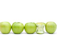 Fresh green apples with one eaten apple Royalty Free Stock Photo