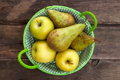 Fresh green apples and pears on a wooden table Royalty Free Stock Photo