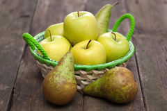 Fresh green apples and pears on a wooden table Stock Photo