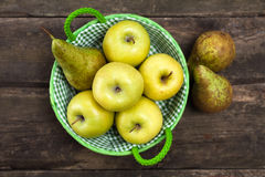 Fresh green apples and pears on a wooden table Stock Image
