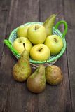Fresh green apples and pears on a wooden table Royalty Free Stock Images