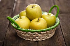 Fresh green apples and pears on a wooden table Stock Images