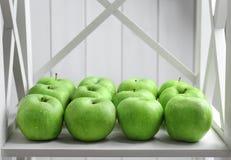 Fresh green apples. On shelf Stock Images