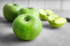 Fresh green apples on table. Closeup Royalty Free Stock Image