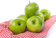 Fresh green apples on towel Royalty Free Stock Images
