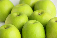 Fresh green apples on a white dish Stock Photography