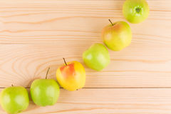 Fresh green apples on wood. Royalty Free Stock Photo