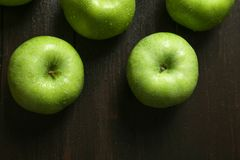 Fresh green apples. On wooden background Stock Images