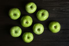 Fresh green apples on wooden background. Top view Stock Photography