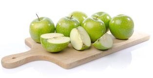 Fresh green apples on wooden board Royalty Free Stock Photo
