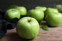 Fresh green apples. On wooden table Stock Photos