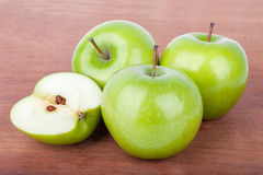 Fresh Green apples on the wooden table Stock Photos