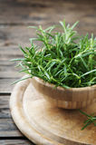 Fresh green aromatic rosemary on the wooden table Royalty Free Stock Images