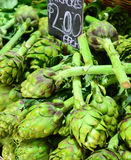 Fresh green artichokes for sale in market Royalty Free Stock Photo