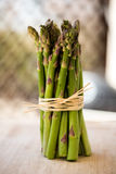 Fresh green asparagus bunch isolated on white. Fresh green asparagus bunch isolated great bokkeh Royalty Free Stock Photography