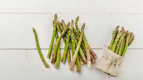 Fresh Green asparagus in a bunch and lots Stock Photos