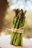 Fresh green asparagus bunch  on white. Fresh green asparagus bunch  great bokkeh Royalty Free Stock Images