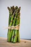 Fresh green asparagus bunch  on white. Fresh green asparagus bunch  great bokkeh Royalty Free Stock Photos