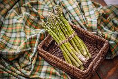 Fresh green asparagus. Bunches of fresh green asparagus in wicker basket Stock Photography