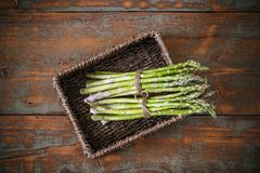 Fresh green asparagus bunches. Top view of fresh green asparagus bunches Stock Photo