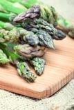 Fresh green asparagus on cutting board stock photo
