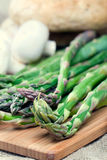 Fresh green asparagus on cutting board stock images