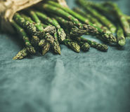 Fresh green asparagus over dark grey linen table cloth background Stock Photo