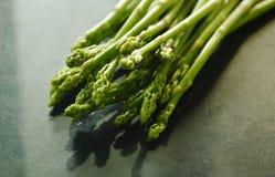 Fresh green asparagus raw food on black counter Royalty Free Stock Photos