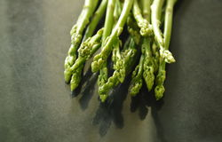 Fresh green asparagus raw food on black counter Royalty Free Stock Photo