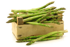 fresh green asparagus shoots in a wooden crate Stock Photos