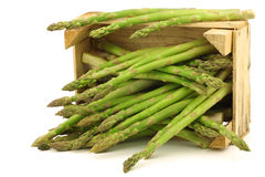 Fresh green asparagus shoots in a wooden crate Royalty Free Stock Photos