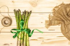 Fresh green asparagus spear on natural wood stock image
