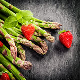 Fresh green asparagus spears and strawberries Royalty Free Stock Photography