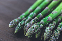 Fresh green asparagus on table. Healthy asparagus resting on table royalty free stock image
