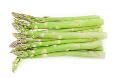 Fresh green asparagus tips on a white background Stock Photos