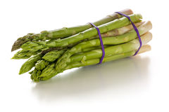 Fresh green asparagus on a white background Royalty Free Stock Photos
