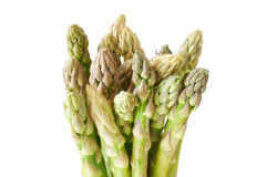 Fresh green asparagus on white. Bunch of fresh green asparagus in front of white background Stock Photography