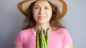 Fresh green asparagus in a woman`s hands stock video