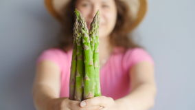 Fresh green asparagus in a woman`s hands stock video footage