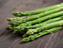 Fresh green asparagus on wooden Stock Images
