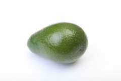 Fresh, green Avocado isolated on a white background. Royalty Free Stock Images