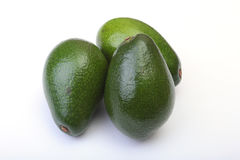 Fresh, green Avocado isolated on a white background. Royalty Free Stock Image