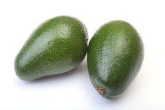 Fresh, green Avocado isolated on a white background. Stock Photos