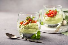Fresh green avocado mousse Royalty Free Stock Images