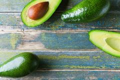 Fresh green avocado on vintage wooden table top view. Organic wellness food background. Copy space for text. Fresh green avocado on vintage wooden table top Royalty Free Stock Photos