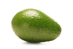 A fresh green avocado on a white background Stock Images