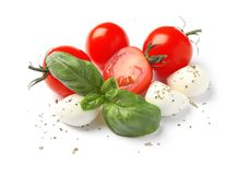 Fresh green basil leaves, cherry tomatoes. And mozzarella on white background stock photography