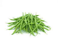 Fresh green beans. A pile of fresh green beans on white background stock images